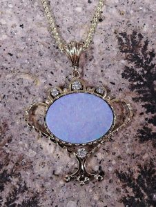 Jimi Wade hand-fabricated opal pendant set in 14K yellow gold with diamond accents