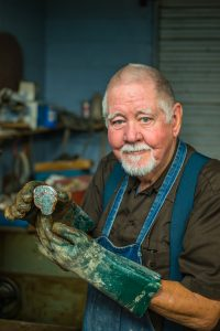 John Gaumer with a freshly cut Hart Mountain Jasper collected by the Gaumer family in Lake County, Oregon