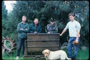 Scott, John, Tom, and Bill Gaumer circa 1994. The Gaumer men after they retrieved an ore car from John O. Gaumer's gold mine near Pentz, Butte County, California.